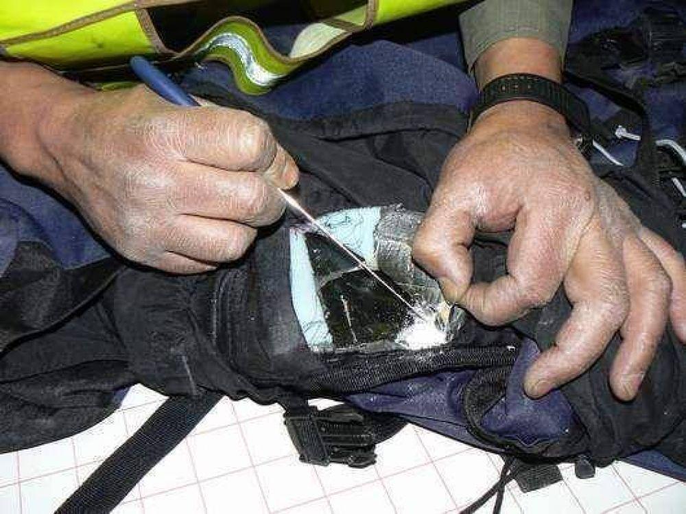 Más de 14 kilos de cocaína transportaban en valijas de doble fondo