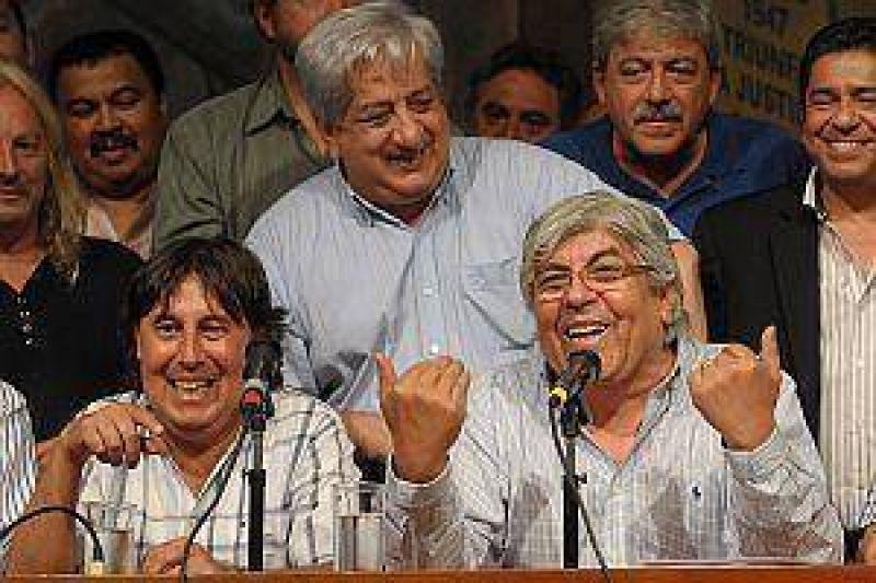 Micheli prepara marcha, mientras Moyano espera dos vueltas de Bulgaria