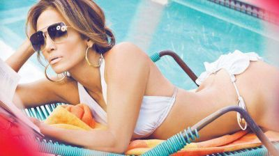 Provocadora, Jennifer Lopez revel� c�mo besa George Clooney