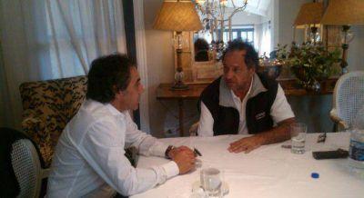 Guzmán se mostró con Scioli para confirmar su regreso al kirchnerismo