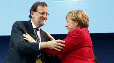 España: Angela Merkel y Nicolas Sarkozy hacen campaña por Mariano Rajoy