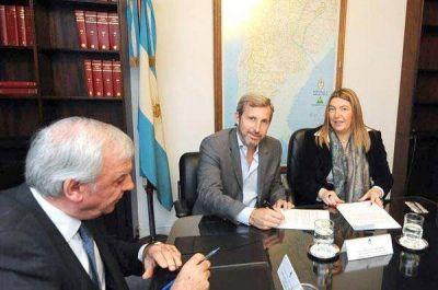 Bertone firmó convenio por 500 millones de pesos con el Fondo Fiduciario
