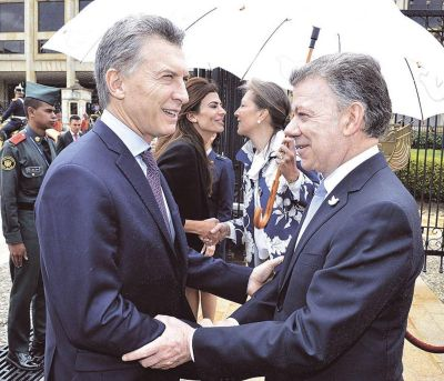 Macri y Santos, por la revocatoria en Venezuela