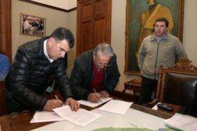 Firma del convenio de concesión de transporte público