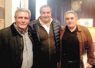 Un triunvirato para unificar a la CGT