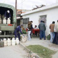 En barrios de Capital contin�a la venta de la garrafa social