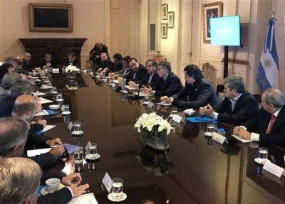 Macri redujo un ministerio e hizo guiños a la UCR en el gabinete
