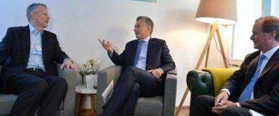 Bordet se reunió en Davos con directivos de Coca Cola por los cítricos entrerrianos
