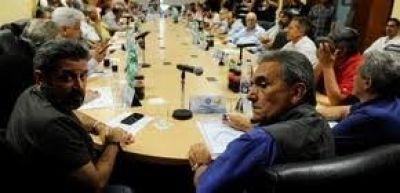 Con cumbres separadas, los jefes sindicales discutieron cómo unificarse en la CGT