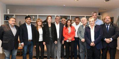 Vidal con gremialistas amigos: