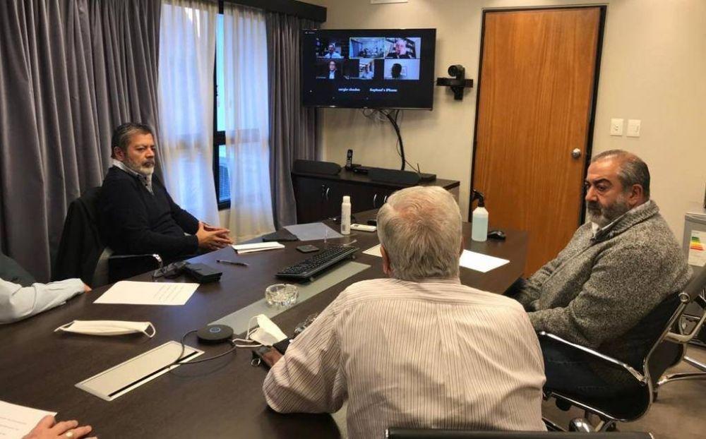 La CGT y la UIA extienden su acuerdo de suspensiones con el 75% del sueldo