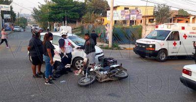 Auto de la Coca Cola derriba a motociclista