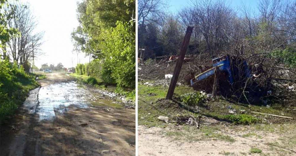 Vecinos reclaman por un basural y una calle anegada por el agua de una parrilla