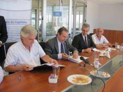 Acuerdo con la Bolsa de Comercio para promover el desarrollo
