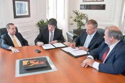 Buzzi y Abal Medina acordaron becas en Ciencia y Tecnología para Chubut