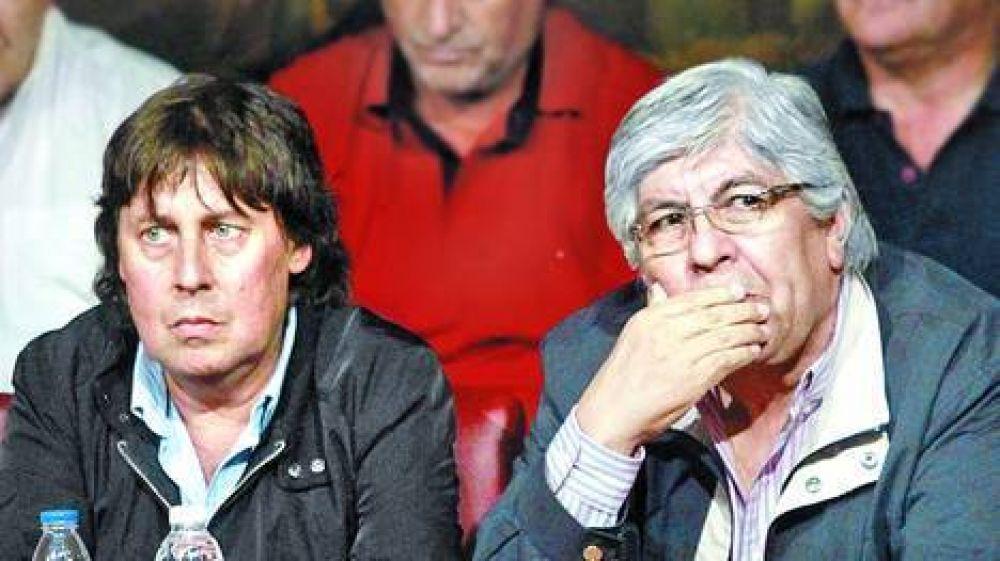 Moyano y Micheli, desunidos por otro paro
