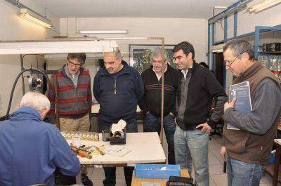 Tigre: Ugo y Piantino junto a trabajadores que buscan recuperar una fábrica